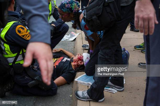 A woman is injured during a clash between protesters and counterprotesters at the Unite the Right rally on Aug 12 2017 in Charlottesville Virginia