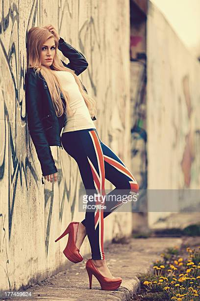Woman is leaning on the wall