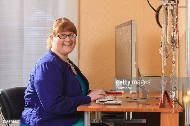Woman is legally blind using large type on her computer screen