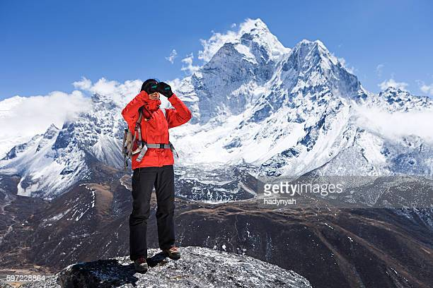 Woman is looking through binoculars in Mount Everest National Park