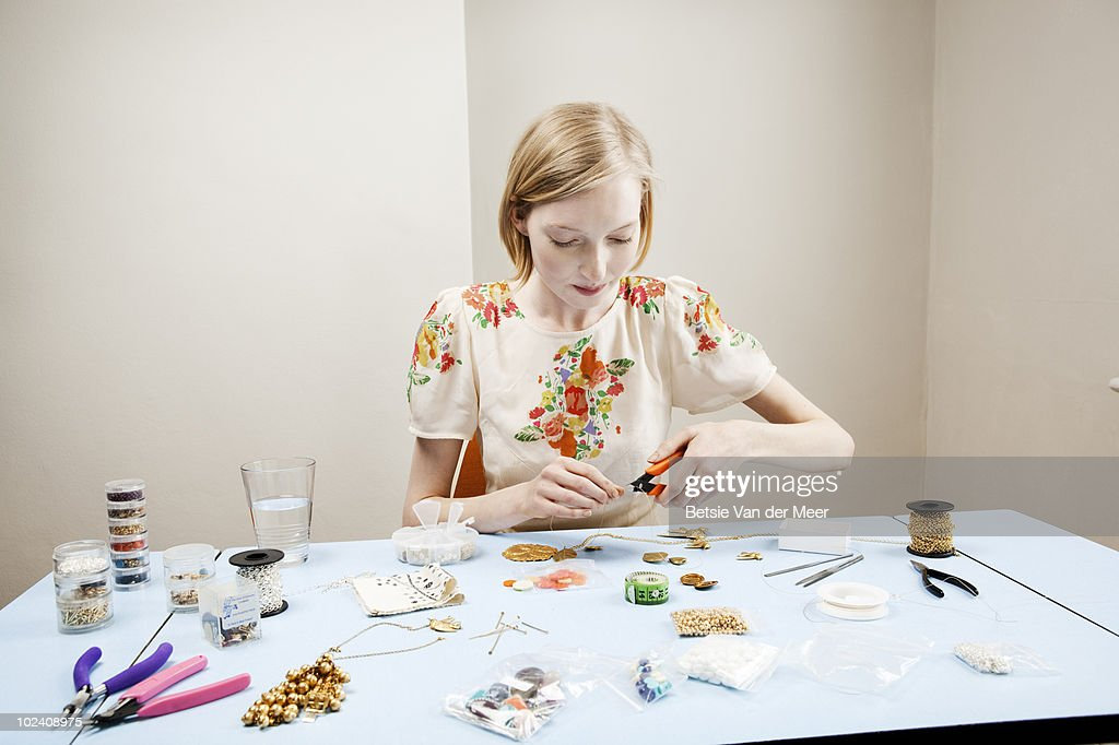 woman is making jewellery. : Stock Photo