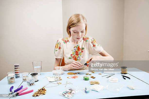 woman is making jewellery. - newpremiumuk stock pictures, royalty-free photos & images
