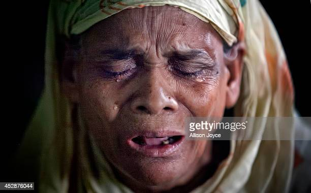 A woman is overcome with emotions as she prays at the National Mosque Baitul Mukarram during Eid alFitr on July 29 2014 in Dhaka Bangladesh Muslims...