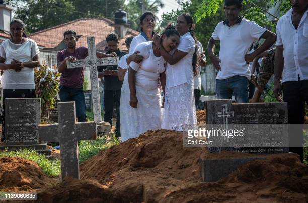 A woman is overcome with grief during a funeral for a person who was killed in the Easter Sunday attack on St Sebastian's Church on April 23 2019 in...