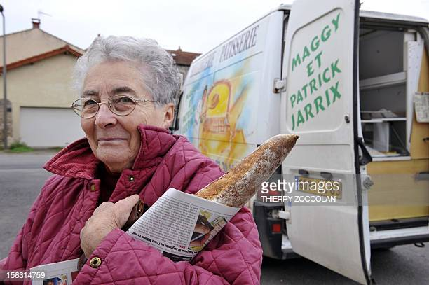 A woman is pictured after buying bread at a truck used as a mobile bakery on November 13 2012 in Sardon central France AFP PHOTO THIERRY ZOCCOLAN