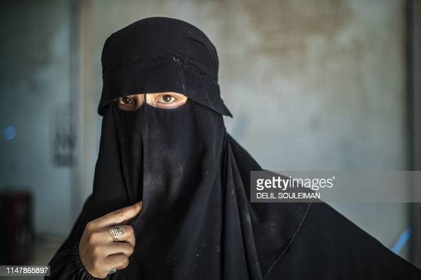A woman is pictured at the AlHol camp in northeastern Syria's AlHasakeh governorate on June 3 as Kurdish authorities started sending home 800 Syrian...