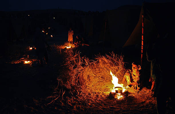 A Woman Is Pictured By Fire In Pakis