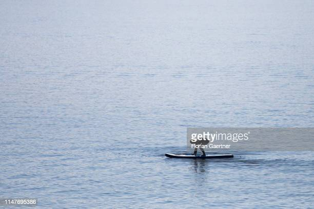 A woman is pictured during standup paddling in the lake Baerwalder See on June 02 2019 in Klitten Germany