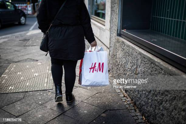 Woman is pictured with a bag of h and m on December 17, 2019 in Berlin, Germany.