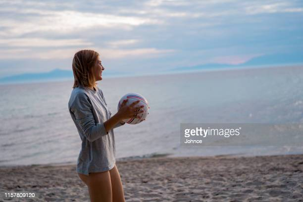 woman is playing volleyball - medium shot stock pictures, royalty-free photos & images