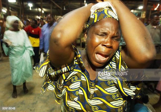 A woman is possessed by the spirit as she prays to God at an all night Pentecostal mass held by the Redeemed Church of Christ on the LagosIbadan...