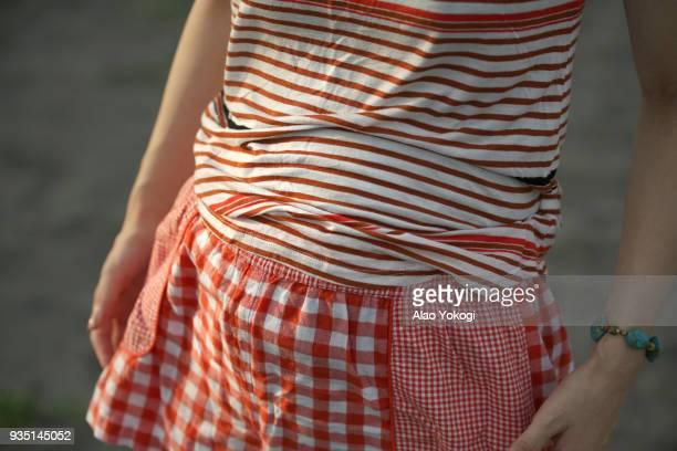 a woman is pregnant - 人体部位 ストックフォトと画像