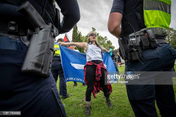 A woman is questioned by members of Victoria Police on October 23 2020 in Melbourne Australia Protesters are calling on the end to lockdown...