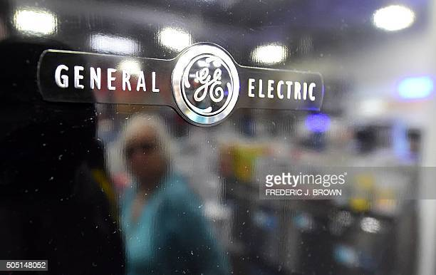 Woman is reflected on the black door of a General Electric refrigerator at a store selling electronics and appliances in Montebello, California on...
