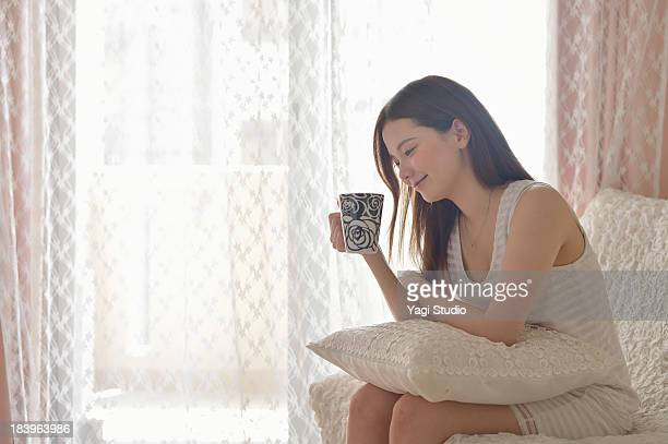 Woman is relaxing in the room.