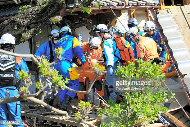 A woman is rescued from a collapsed house on April 16 2016 in Mashiki Kumamoto Japan The magnitude 73 earthquake hit Kyushu just after the earthquake...