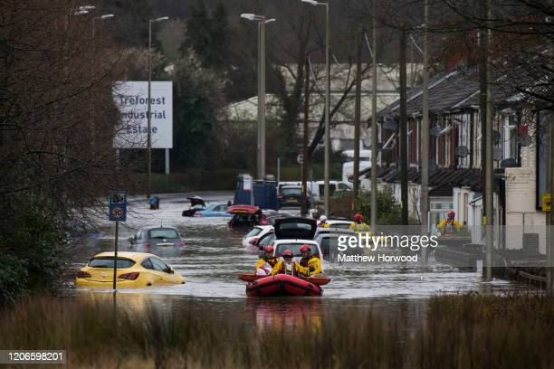 A woman is rescued from a property on Oxford Street on February 16 2020 in Nantgarw WalesThe Met Office have issued a red weather warning for rain in...