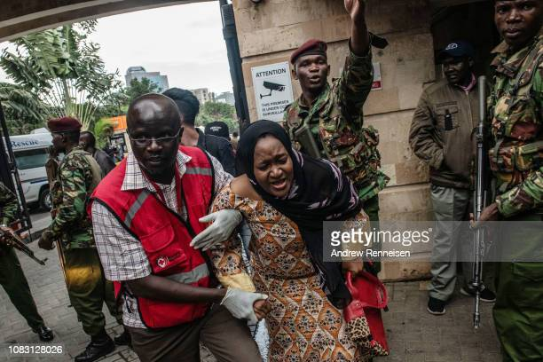 A woman is rescued from the Dusit Hotel on January 15 2018 in Nairobi Kenya A current security operation is underway after terrorists attacked the...