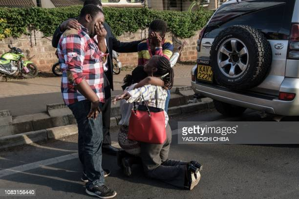 A woman is reunited with her family after her evacuation from DusitD2 compound in Nairobi after a blast followed by a gun battle rocked the upmarket...