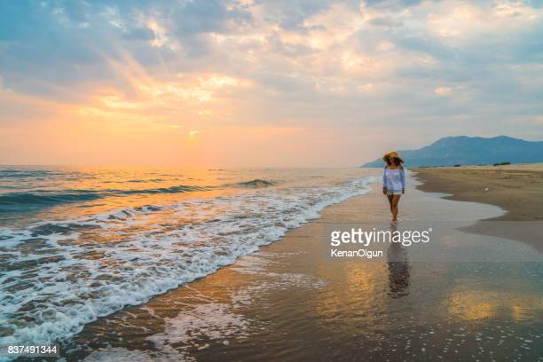 Woman is running to the sea