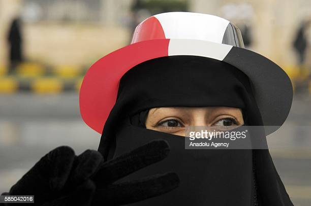 A woman is seen as people gather to support the 'supreme council' which was established for state affairs by Houthi and former President Ali Abdullah...