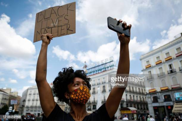 A woman is seen during a protest against racism and police brutality in Madrid Spain on June 7 2020 Hundreds of people gathered in Madrid to march...