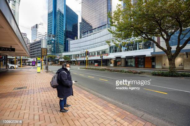 A woman is seen empty Lambton Quay main shopping precinct during the lockdown due to coronavirus pandemic in Wellington New Zealand on April 3 2020
