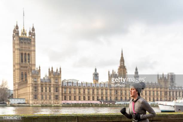 Woman is seen exercising by the Thames River as the UK's government introduced strict Coronavirus restrictions earlier this month due to sharp...