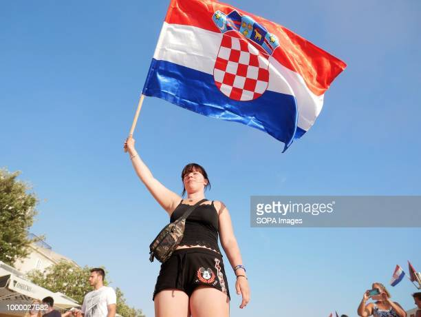 A woman is seen holding a Croatian flag Croatians in the Island of Pag watched the world cup football final match Croatia vs France Croatia lost 24...