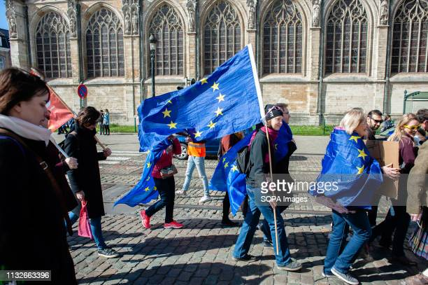 A woman is seen holding a flag of the EU during the protest A day before the anniversary of the founding Treaty of the European Union citizens and...