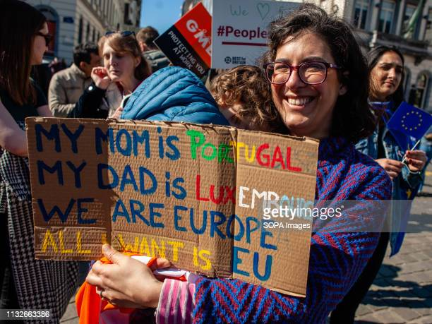 A woman is seen holding a placard during the protest A day before the anniversary of the founding Treaty of the European Union citizens and civil...