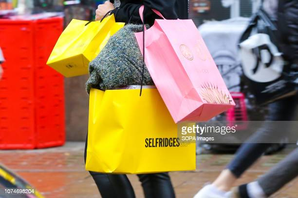 Woman is seen holding shopping bags on London's Oxford Street. Last minute Christmas shoppers take advantage of pre-Christmas bargains at Oxford...