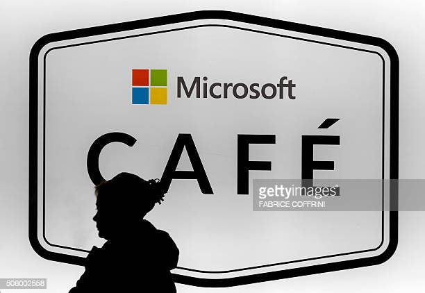 A woman is seen in silhouette walking past the Microsoft cafe at the World Economic Forum annual meeting in Davos on January 21 2016 Rising risks to...