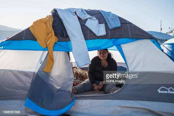A woman is seen inside her tent at the new migrant shelter where around 6000 people are waiting to apply for asylum in the United States