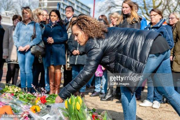 OKTOBERPLEIN 24 UTRECHT UTRECHT NETHERLANDS A woman is seen laying a bunch of flowers at the memorial site The day after three people were killed and...