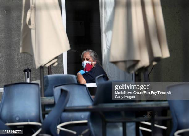 A woman is seen on the patio of the Gateway Care and Rehabilitation Center in Hayward Calif on Wednesday April 8 2020 Six patients there have died of...