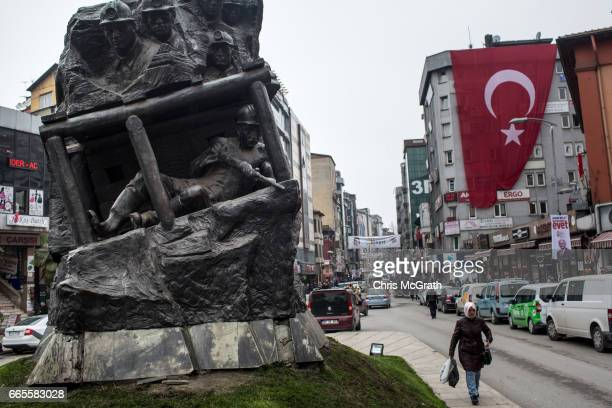 Woman is seen passing a coal mining sculpture in the town center on April 5, 2017 in Zonguldak, Turkey. More than 300 kilometers of coal mineÕs...