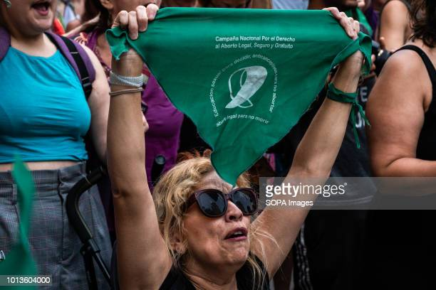 Woman is seen showing out a green handkerchief during the protest. 300 people, mostly argentines and women gathered before the Consulate of Argentina...