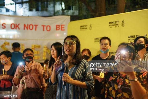 Woman is seen speaking during the one month abduction anniversary of Wanchalearm Satsaksit, a Thai critic. People participated in a one month...