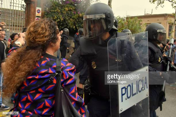 A woman is seen speaking to the Spanish Police National Police entered by force in the High School of L´Hospitalet City where they have requisitioned...