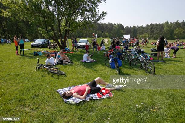 A woman is seen sunbathing in Myslecinek park in Bydgoszcz Poland on 20 May 2017 After several weeks of below average temperatures the weekend will...