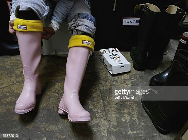 A woman is seen trying on a pair of Hunter wellington boots at the factory shop on April 20 in Dumfries ScotlandThe iconic wellington boot company...