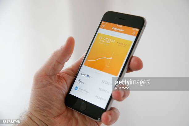 A woman is seen using the Empower app on 10 May 2017 Founder Warren Hogarth developed the app to help millenials manage their finances and eventually...
