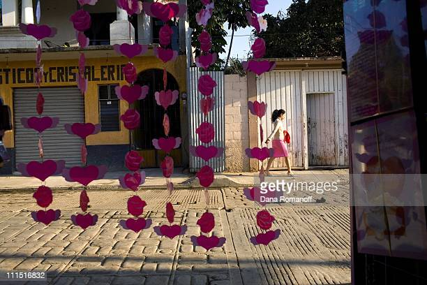 A woman is seen walking down the street on February 13 2008 through the doorway of a gift shop in the town of San Pablo Huixtepec Women say the ratio...