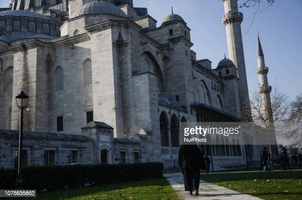 A woman is seen walking in front the Suleymaniye mosque in IstanbulTurkey People enjoying the good weather Taking a walk on the streets of largest...
