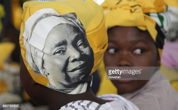 A woman is seen wearing a doek adorned with Nkosazana DlaminiZumas face during the prayer party organized by the Dlamini Clan in her home Bulwer on...