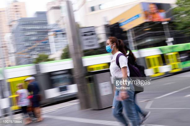 A woman is seen wearing a face mask as preventative measure as COVID19 continues to spread across Australia on March 18 2020 in Melbourne Australia...