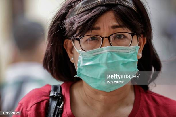 A woman is seen wearing a face mask as public fear over China's Wuhan Coronavirus grows on February 3 2020 in Manila Philippines The Philippine...
