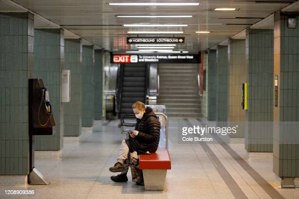 Woman is seen wearing a mask in the subway during morning commuting hours as Toronto copes with a shutdown due to the Coronavirus, on April 1, 2020...