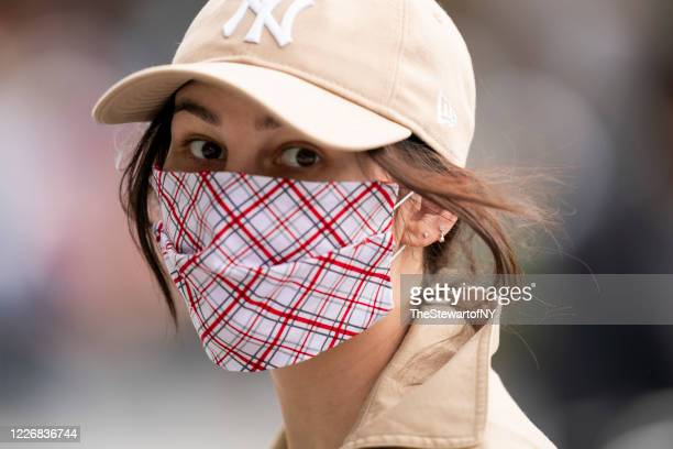 Woman is seen wearing a plaid protective face mask during the coronavirus pandemic in Washington Square Park on May 24, 2020 in New York City.